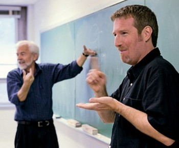 Picture of a professor at blackboard next to an ASL interpreter