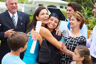 Photo of Latino family celebrating daughter's graduation.